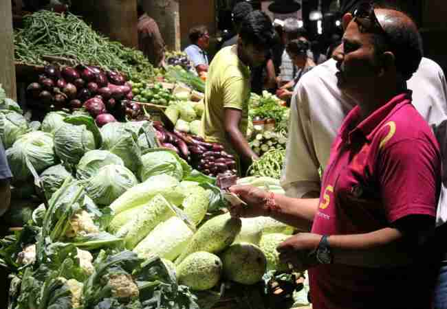 Buying vegetables at Port Louis market