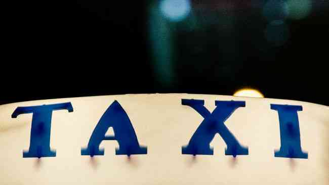 Taxi sign on roof