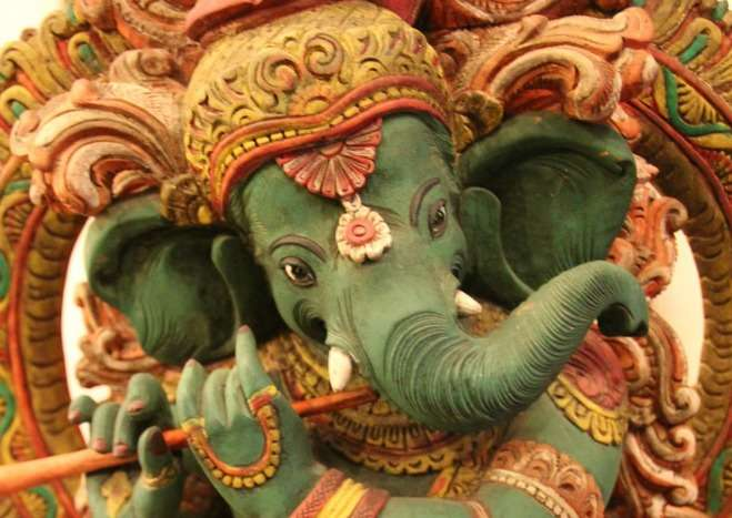 Ganesh playing the flute