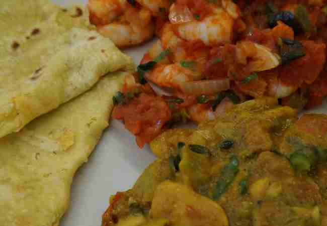 Mauritian food rougaille, curry and dholl puris