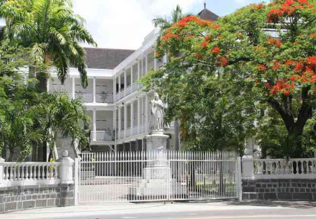 Government house with Queen Victoria statue
