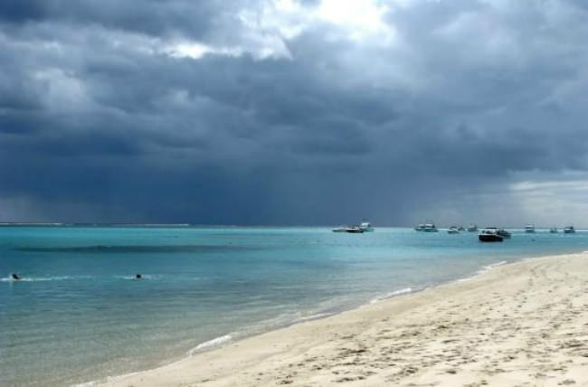 The coming of rain over the sea